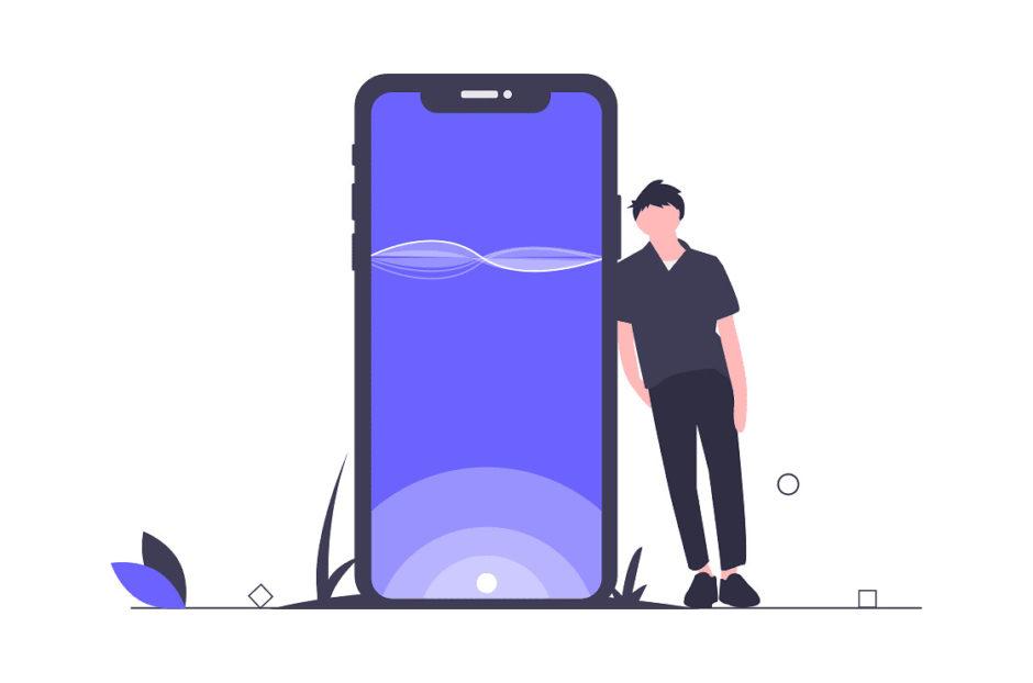 携帯のアプリケーションを利用する男性の画像。