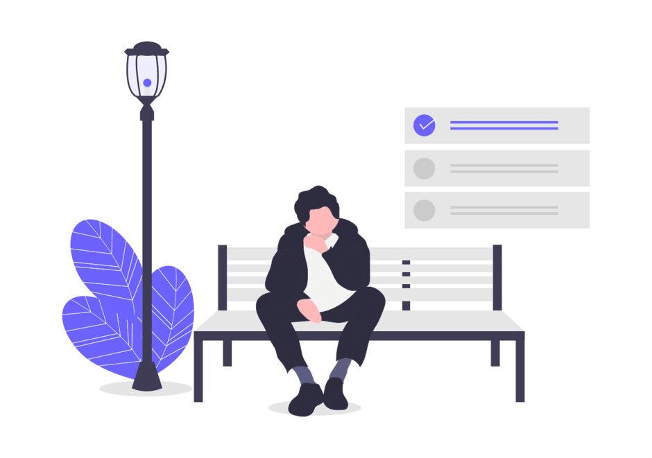 男性がベンチに座りながら考えている画像。
