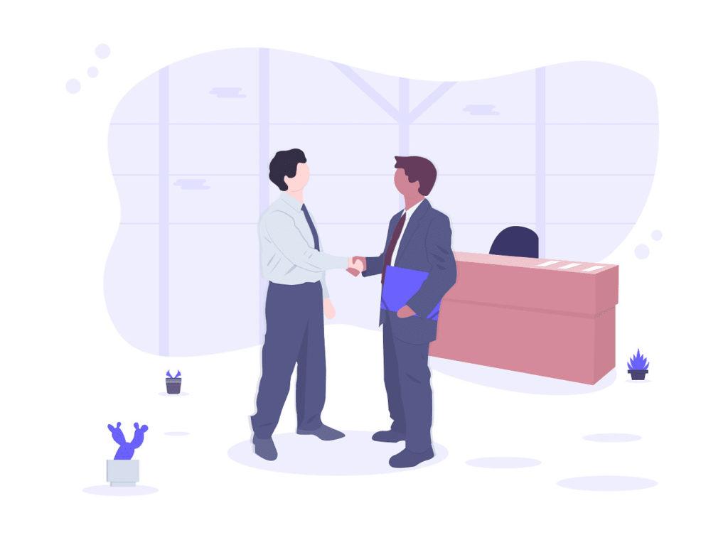 握手をし合う2人のビジネスマンの画像。
