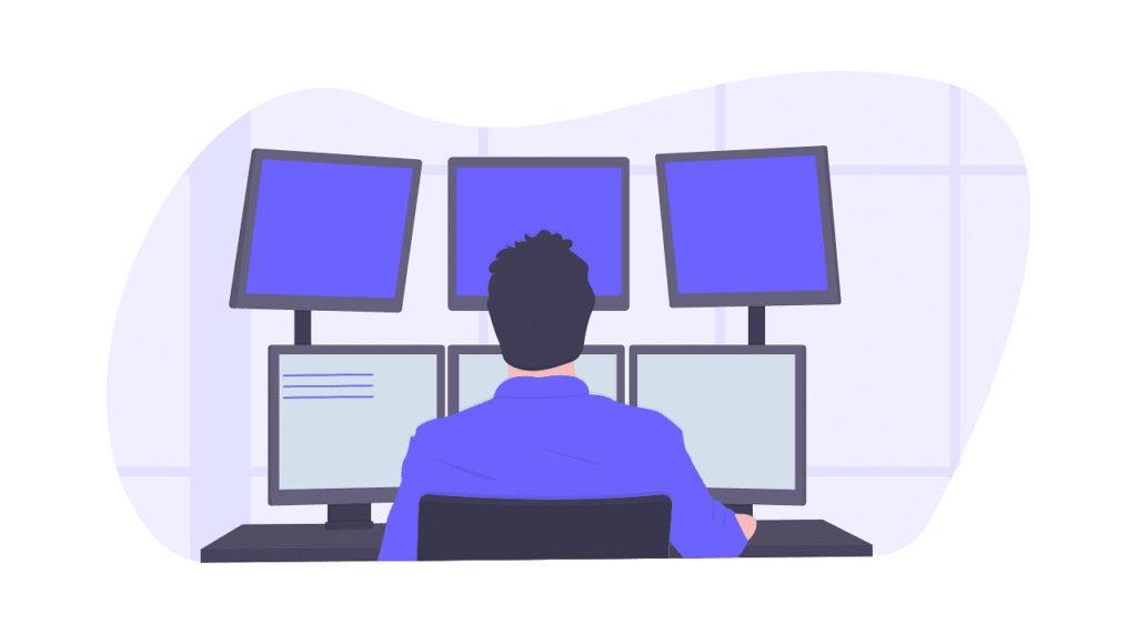 男性がプログラミングをしている画像。