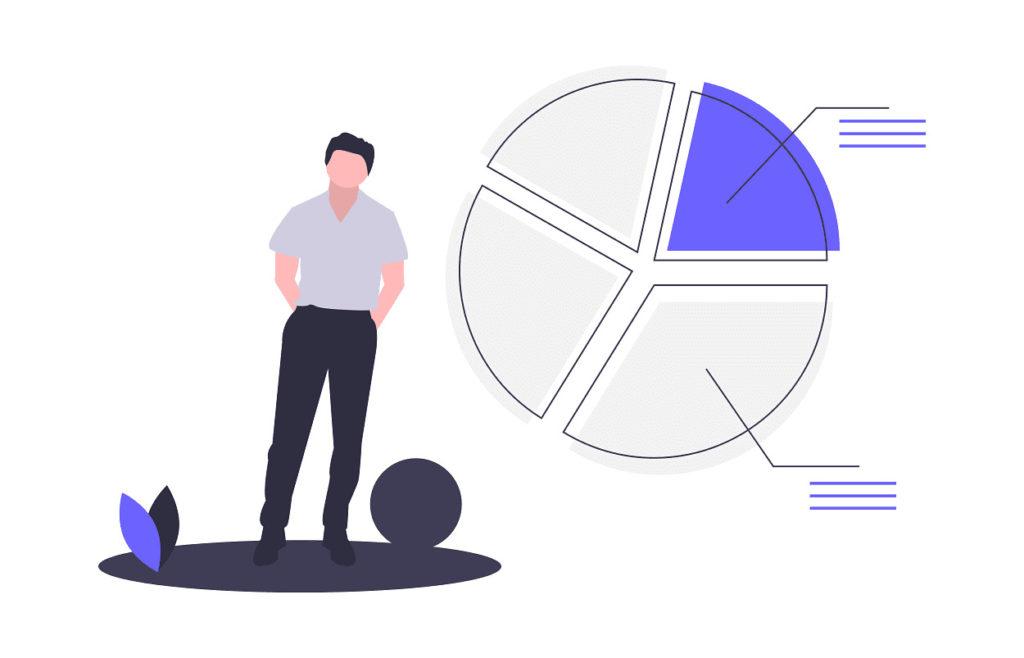男性が円グラフのデータを見ている画像。