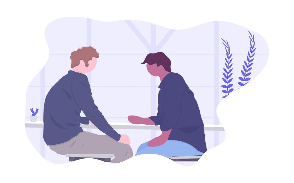 二人の男性が話す画像。