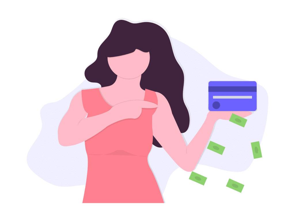 クレジットカードを使う女性の画像。
