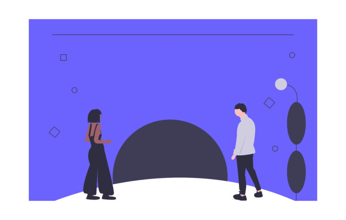 男性と女性がトンネルに入ろうとする画像。