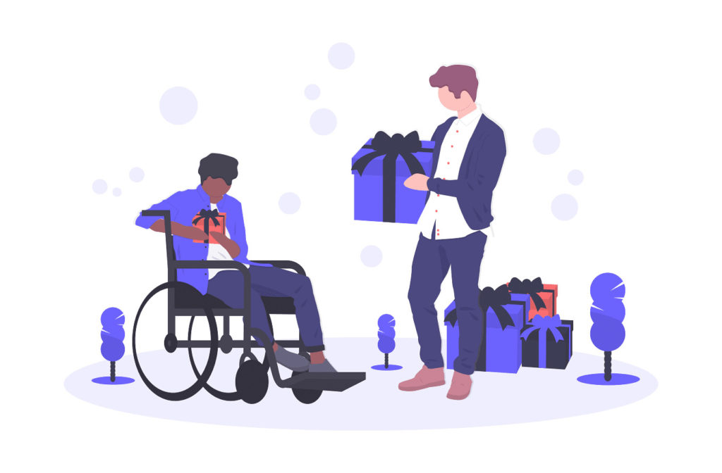 車いすの男性にプレゼントを渡す画像。