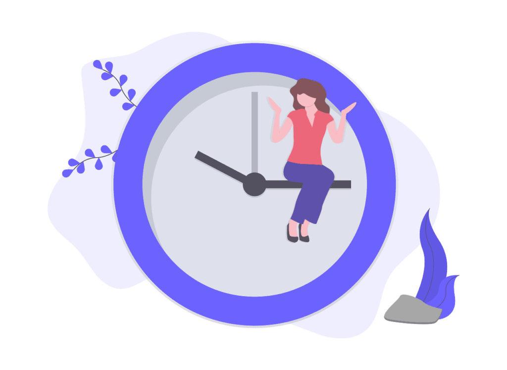 時計に座る女性の画像。