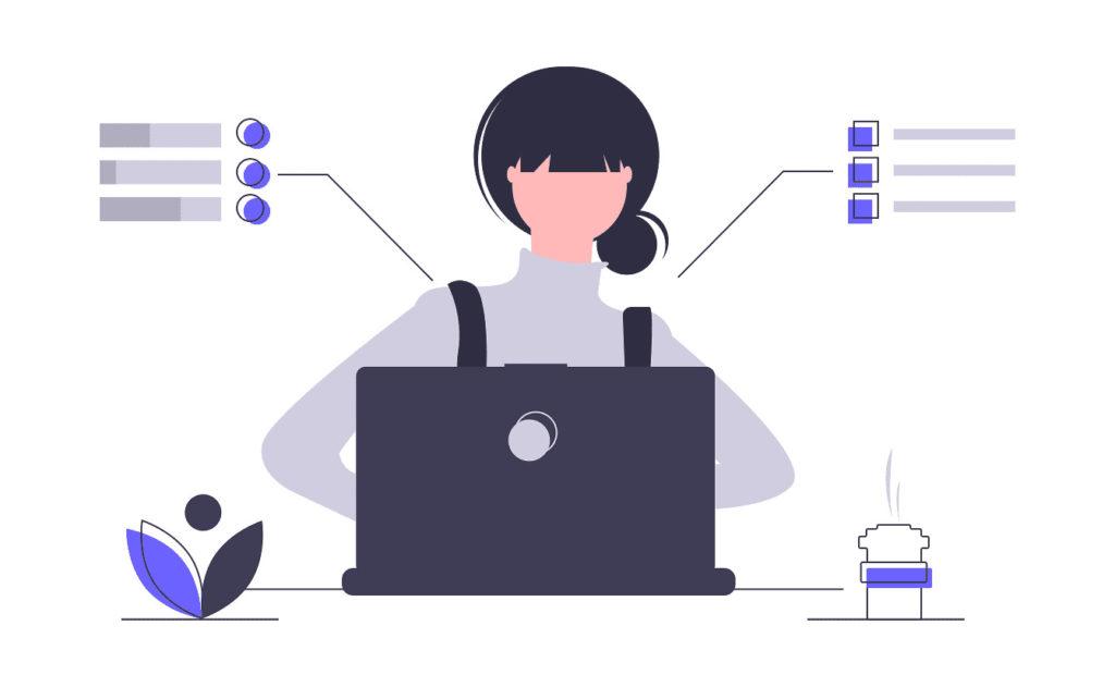 パソコンを見る女性の画像。