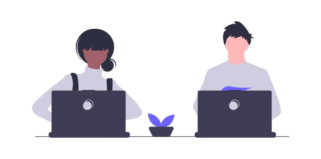 シェアワークスペースで働く男女の画像。