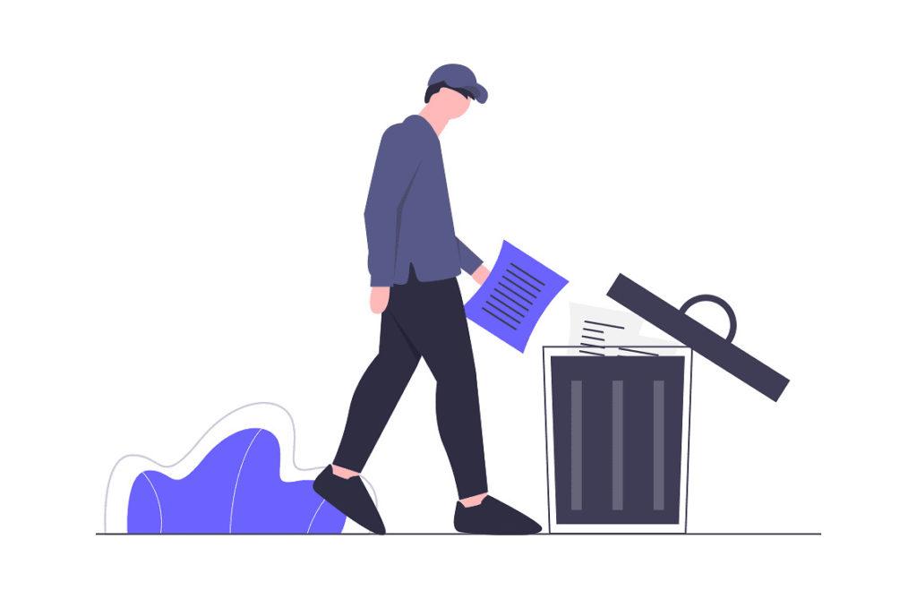 男性がゴミを捨てている画像。