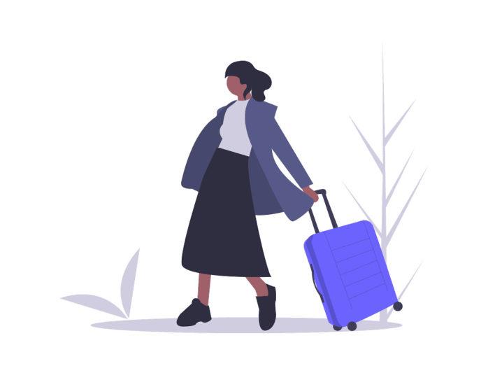 旅行する女性の画像。