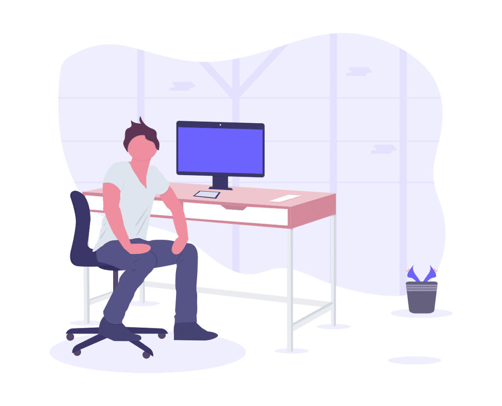 パソコンを前にイスに座った男性