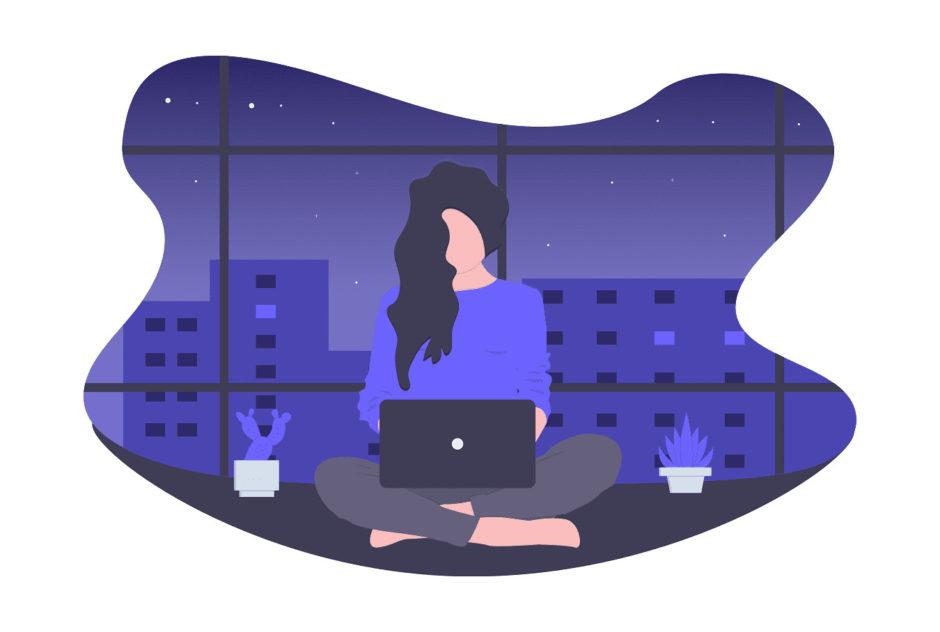 夜遅くまで働く女性の画像。