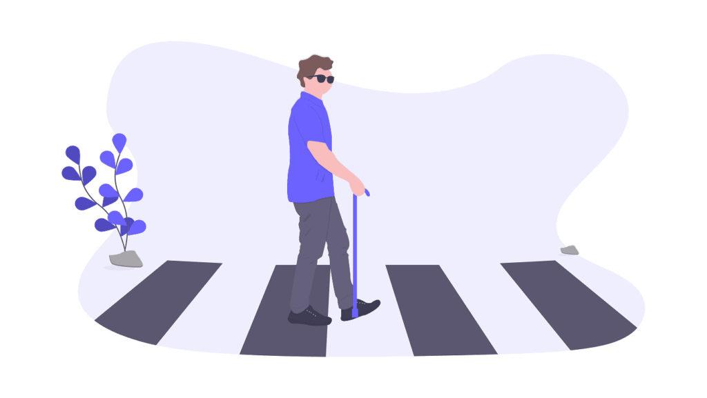 ご老人が横断歩道を渡っている画像。
