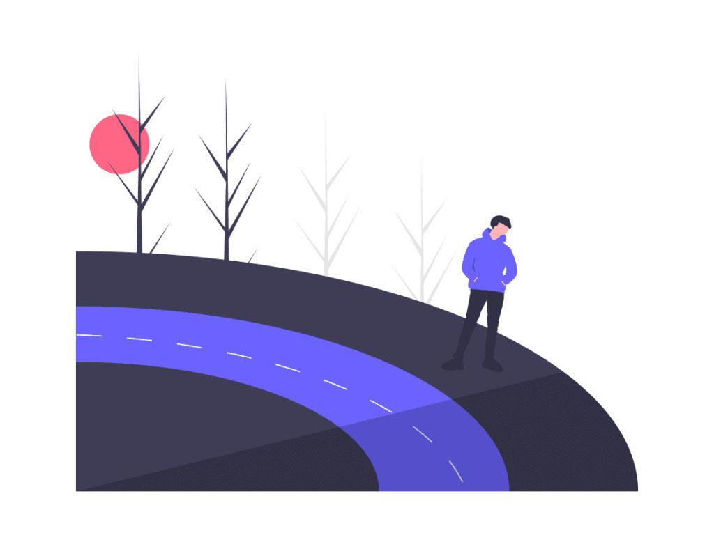道にたたずむ男性の画像。