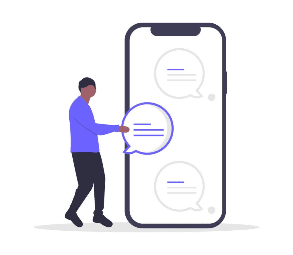 携帯のメッセージを確認する男性の画像。