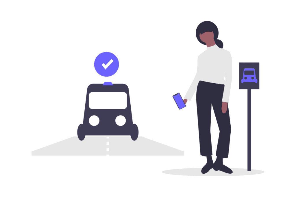 タクシーを呼ぶ女性の画像。
