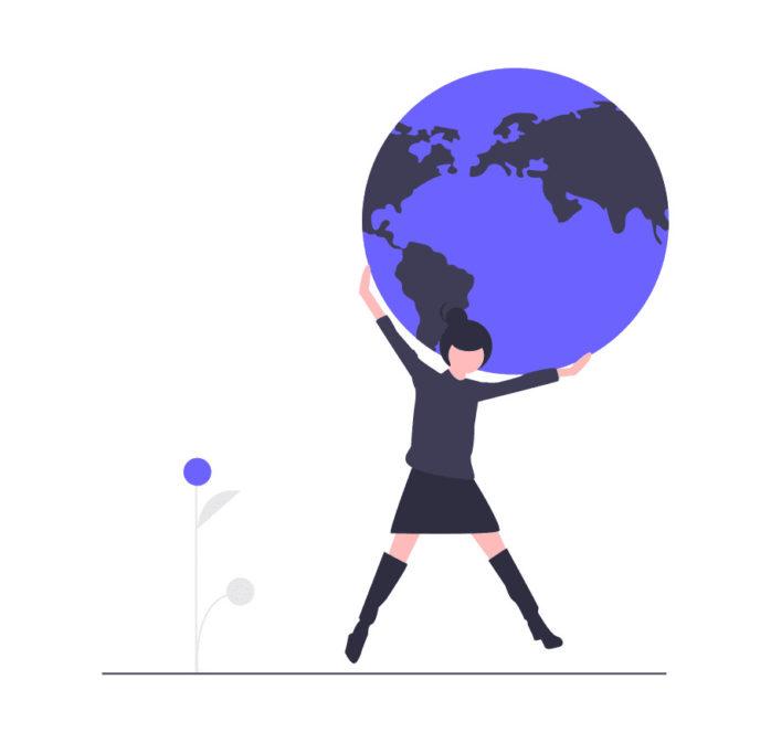 世界を持つ女性の画像。