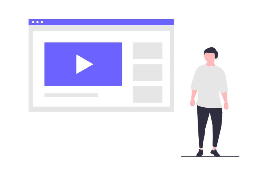 ビデオを見る男性の画像。