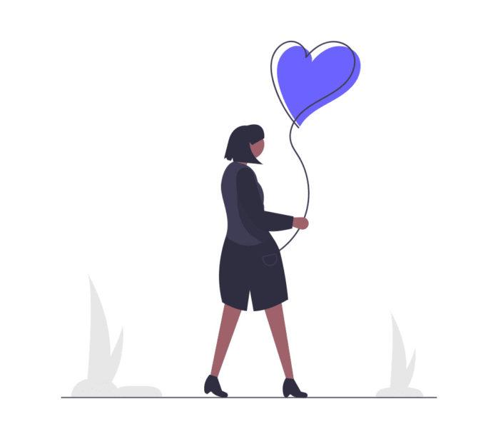 愛と一緒にいる女性の画像。