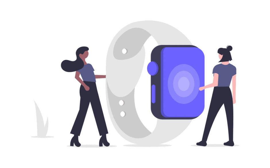 時計のアプリケーションを使う二人の女性の画像。
