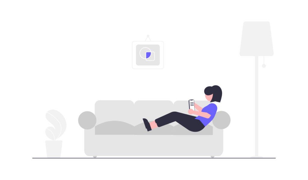 家でリラックスする女性の画像。