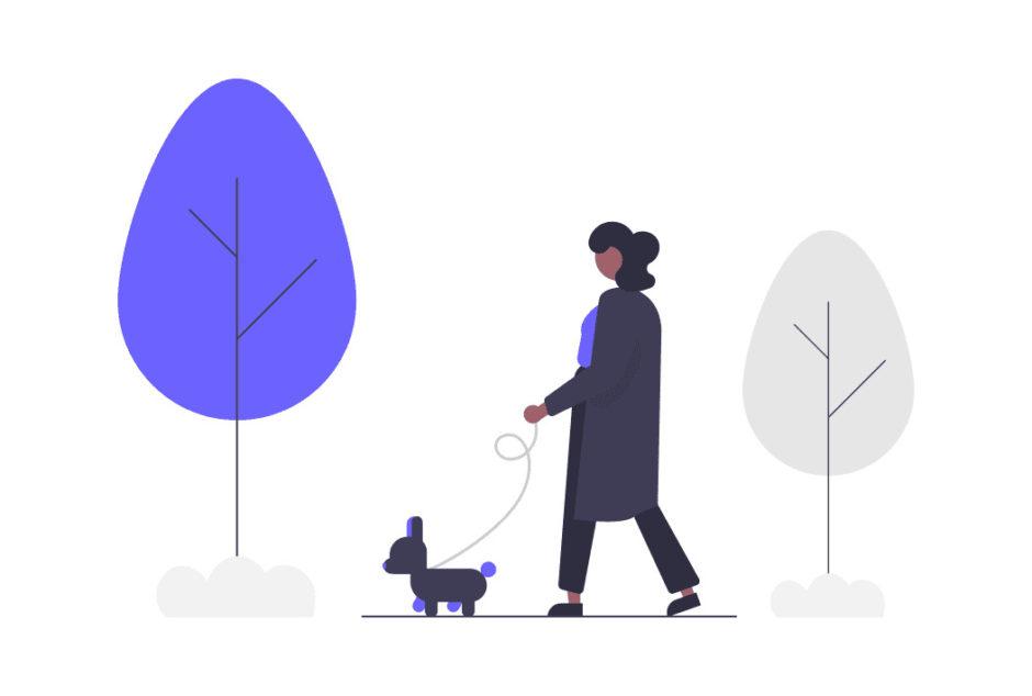リラックスして犬と歩く女性の画像。
